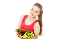 Piękna młoda kobieta z warzywami odizolowywającymi Obraz Stock
