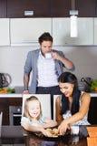 Piękna mała dziewczynka pije mleko i ciastka Obraz Royalty Free