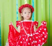 Piękna mała dziewczynka w czerwonej sukni Obrazy Royalty Free