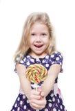Piękna mała dziewczynka z lizakiem odizolowywającym Zdjęcia Stock