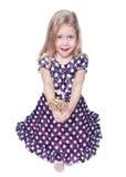 Piękna mała dziewczynka z lizakiem odizolowywającym Odgórny widok Obrazy Stock