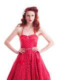 Piękna retro szpilki dziewczyna z czerwoną polki kropki suknią Obraz Stock