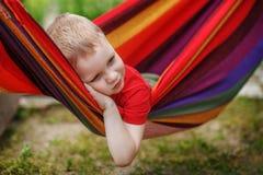 Piękna rozochocona chłopiec odpoczywa w hamaku Obraz Royalty Free