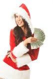 Piękna Santa kobieta trzyma klamerkę połysku pieniądze zdjęcia stock