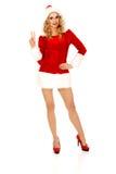 Piękna Santa kobieta wskazuje coś obrazy royalty free