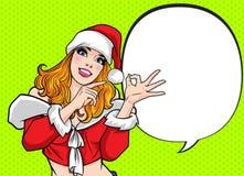 Piękna Santa kobieta wskazuje coś i rękę w górę ok akcji royalty ilustracja