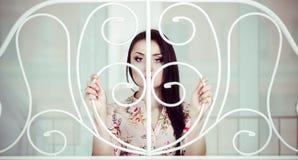 Piękna smutna kobieta z długie włosy behind barami Fotografia Royalty Free