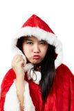 Piękna szczęśliwa azjatykcia dziewczyna w Święty Mikołaj odziewa Zdjęcie Royalty Free