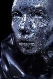 Piękna twarz kobieta zakrywająca w dużej błyskotliwości Fotografia Stock