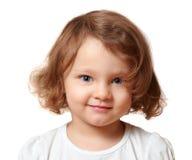 Piękna uśmiechnięta dzieciak dziewczyna odizolowywająca obrazy stock