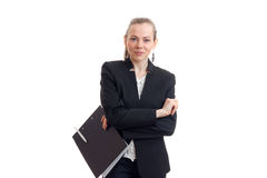 Piękna uśmiechnięta dziewczyny pozycja w Biurowym kostiumu z pastylek rękami składać Fotografia Stock
