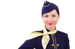 Piękna uśmiechnięta stewardesa w mundurze odizolowywającym fotografia stock