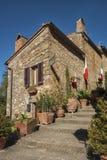 Piękna wąska ulica w małej magicznej i starej wiosce Pienza, Tuscany Obraz Royalty Free