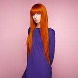 piękna włosiana portreta czerwieni kobieta Fotografia Stock