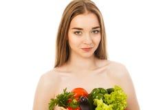 Piękna zdrowa kobieta z warzywami odizolowywającymi Zdjęcia Stock