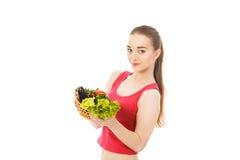 Piękna zdrowa kobieta z warzywami odizolowywającymi Obraz Royalty Free