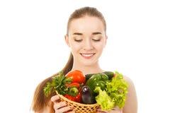 Piękna zdrowa kobieta z warzywami odizolowywającymi Zdjęcie Stock