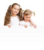 Piękne siostry z deską Obrazy Royalty Free