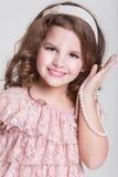 Pięknego dziecka portret, mała dziewczynka ono uśmiecha się, studio Zdjęcie Royalty Free