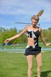 Pięknej blondynki żeński twirler lub majorette wykonujemy Fotografia Stock
