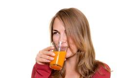 pięknej dziewczyny szklana soku pomarańcze Fotografia Stock