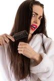 Pięknej kobiety włosy zgrzywiona grępla Fotografia Stock
