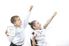 Piękni dzieci są uczniami w klasie wpólnie przy szkołą dalej Obraz Royalty Free