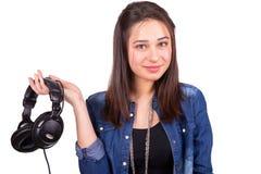 Piękni dziewczyny mienia hełmofony w ręce Obrazy Royalty Free