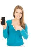 Piękni kobieta punkty przy telefonem Zdjęcie Stock