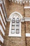 Piękny antykwarski okno z fryzami Fotografia Stock