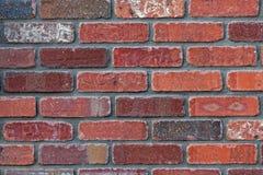 Piękny czerwony ściana z cegieł zmieniający kamieniarstwo kolory Fotografia Stock