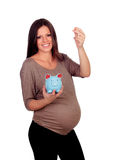 Piękny kobieta w ciąży z błękitnym moneybox Fotografia Royalty Free