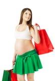 Piękny kobieta w ciąży z torba na zakupy Fotografia Stock