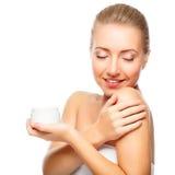 Piękny kobiety oferty słój moisturizer Obraz Stock