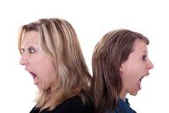 piękny krzyczący kobiety dwa potomstwa Zdjęcia Stock