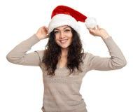 Piękny młoda kobieta portret w Santa pomagiera kapeluszu pozuje na bielu Zdjęcia Stock