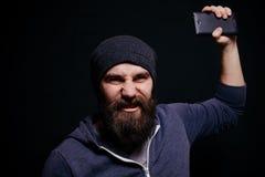 Piękny młody człowiek z brodą robi jaźni Zdjęcie Royalty Free