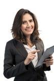 Piękny nowożytny biznesowej kobiety mienia pastylki komputer Zdjęcia Royalty Free