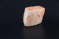 Piękny półszlachetny kamień na czarnym tle Obrazy Stock
