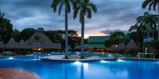 Piękny pływacki basen przy zmierzchem Zdjęcie Royalty Free