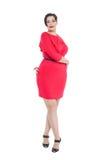 Piękny plus wielkościowa kobieta w czerwieni smokingowy pozować Obraz Royalty Free