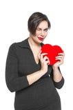 Piękny plus wielkościowa kobieta z czerwony serca mrugać odizolowywam Fotografia Stock