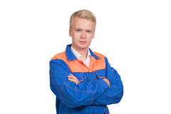 Piękny portret pomyślny pracownik w błękita mundurze odizolowywającym na białym tle Fotografia Royalty Free