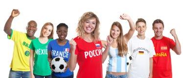 Piękny rosyjski piłka nożna zwolennik z fan od innego countrie zdjęcia royalty free