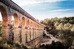 Piękny widok rzymski Akwedukt Pont Del Diable w Tarragona przy zmierzchem zdjęcia stock