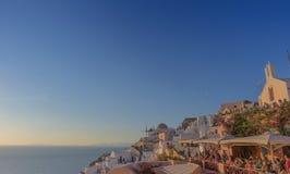 Piękny zmierzch przy sławnym miejscem Oia, Santorini Gre fotografia stock