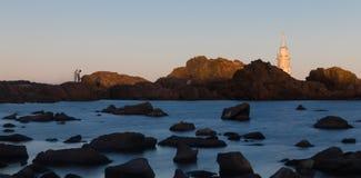 Piękny zmierzch przy Starą latarnią morską w porcie Ahtopol, Czarnym Obrazy Stock