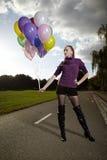 Ładna dama pozuje z balonami Zdjęcie Royalty Free