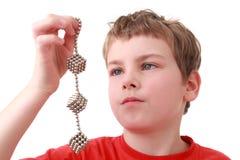 piłek chłopiec sześcianów utrzymania metal Zdjęcia Royalty Free