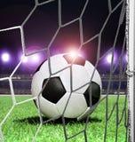 Piłka na stadium przy nocą Fotografia Stock